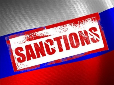 "EU keeps Russia sanctions in place, sees ""encouraging"" signs"