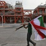 Iran inks $460 million oil deal, anticipating an end to sanctions