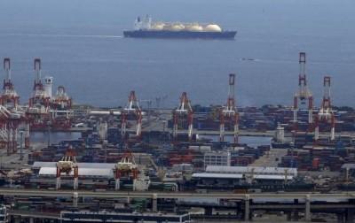 A LNG tanker is seen behind a port in Yokohama