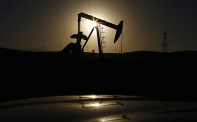 A pump jack is seen at sunrise near Bakersfield