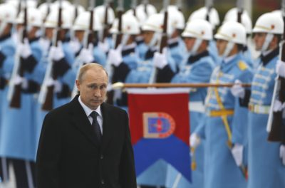 Russia's President Putin reviews a guard of honour during a welcoming ceremony at the Presidential Palace in Ankara