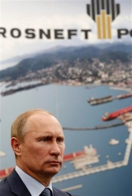 Russian President Vladimir Putin attends a signing ceremony of an agreement between state-controlled Russian oil company Rosneft and Exxon Mobil corporation at the Black Sea port of Tuapse, southern Russia, Friday, June 15, 2012. (AP Photo/RIA-Novosti, Mikhail Klimentyev, Presidential Press Service)
